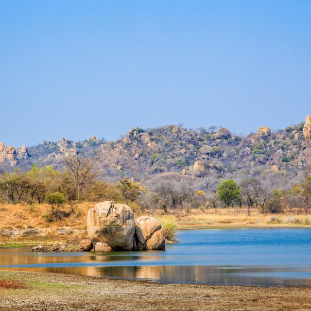 """""""Lake surrounded by rocks, in Matobo National Park, Zimbabwe. September 26, 2016."""" stock image"""