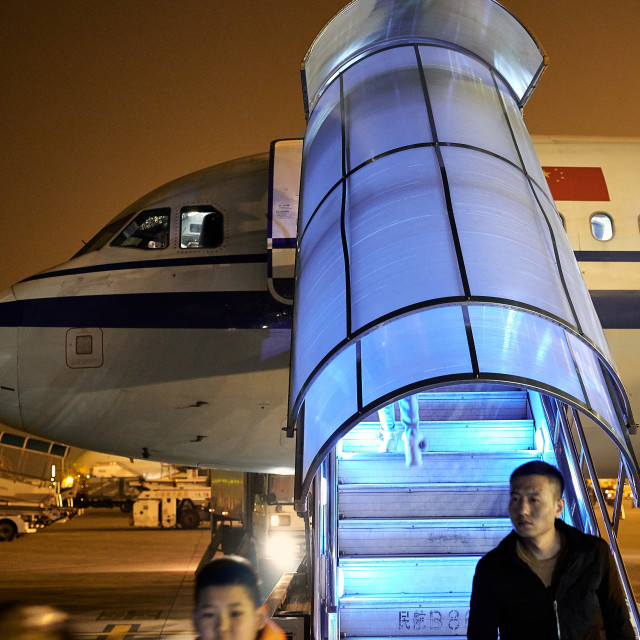 """Passenger Aircraft jetway at night"" stock image"