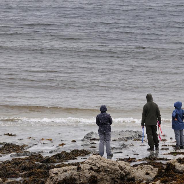 """Family on a beach, Isle of Skye"" stock image"