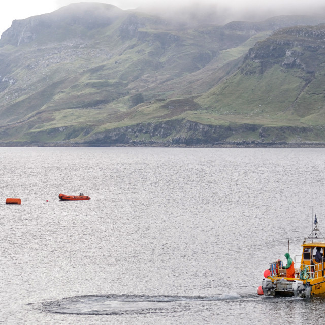 """""""Fishing boat head out from the harbour, Isle of Skye"""" stock image"""