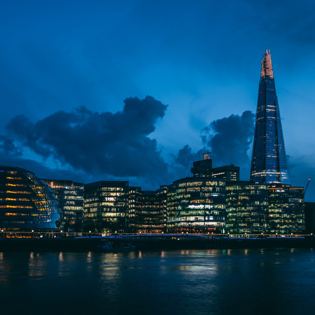 """Modern London skyline on River Thames at night"" stock image"