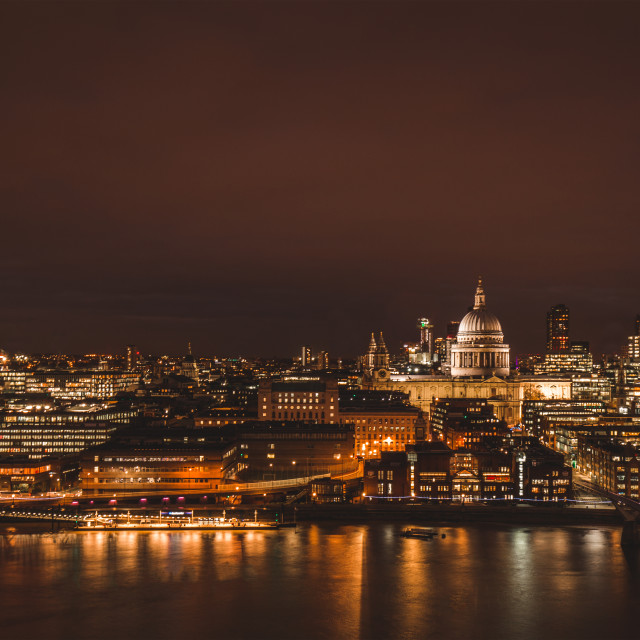 """London aerial view of modern city skyline at night on River Tham"" stock image"