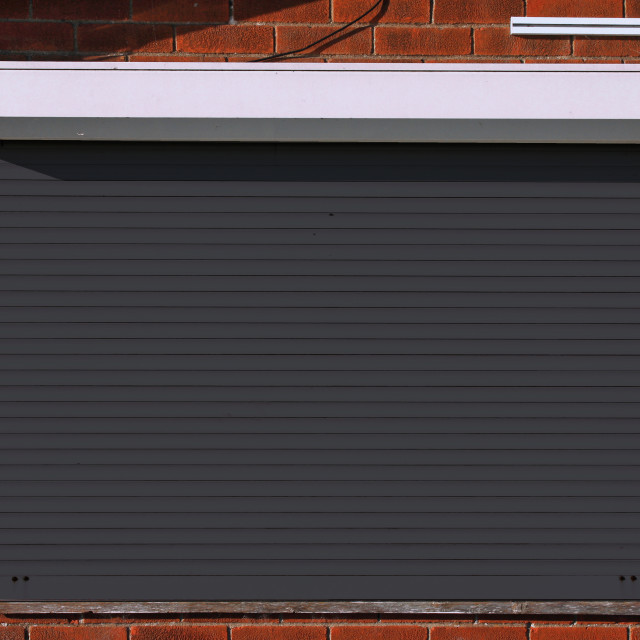 """""""Closed black security shutters"""" stock image"""