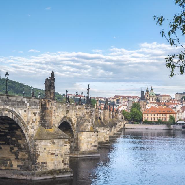 """Charles Bridge on the side and Prague city"" stock image"
