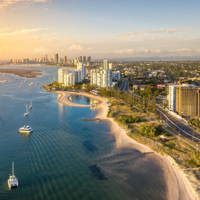 """Aerial View - Sunrise at Gold Coast, Australia with a boat passing by"" stock image"