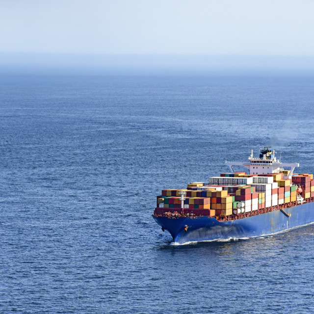 """Cargo ship over ocean"" stock image"