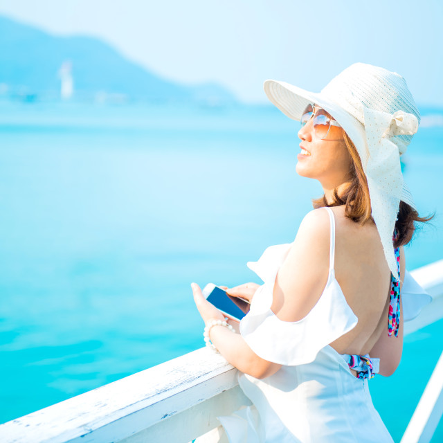 """Women travel alone at the sea and beach on Summer. Chonburi Thailand."" stock image"