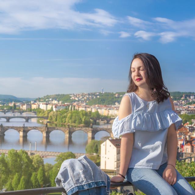 """Beautiful woman and Vltava river in Prague"" stock image"