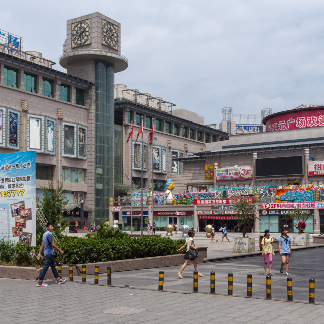 """Xian, China - August 5, 2012: People walking outside of a shopping mall in the city of Xian, in China, Asia"" stock image"