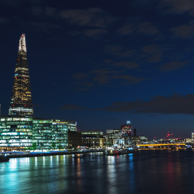 """Panoramic view of London skyline at night on River Thames"" stock image"