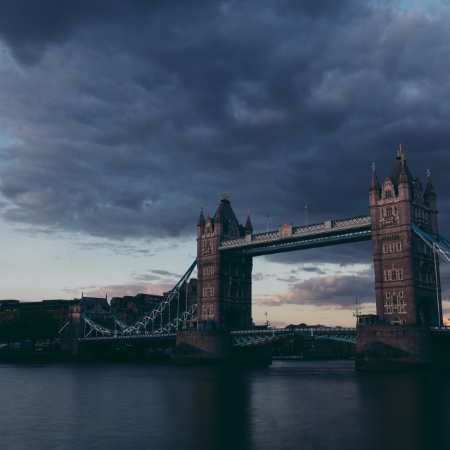 """Moody dark shot of Tower Bridge on London skyline at sunset"" stock image"