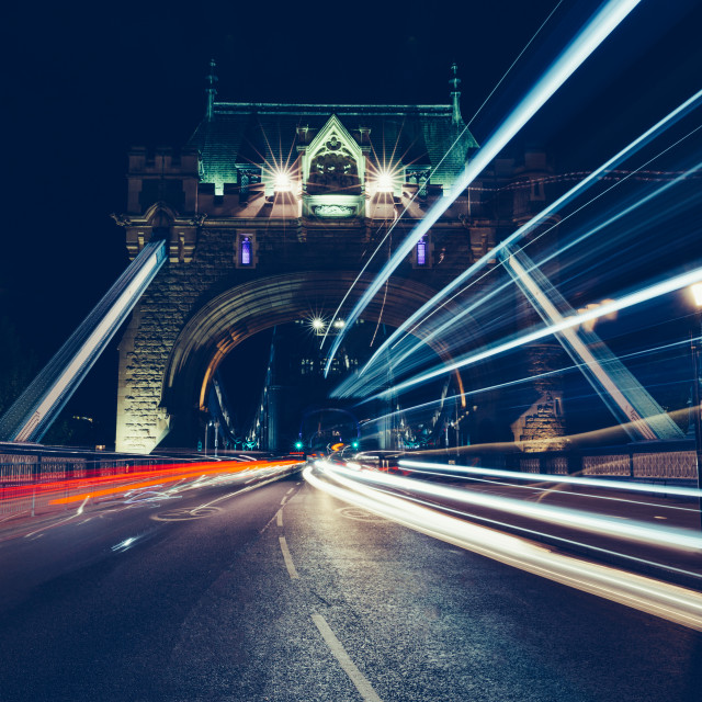 """City light trails of traffic on Tower Bridge London at night"" stock image"