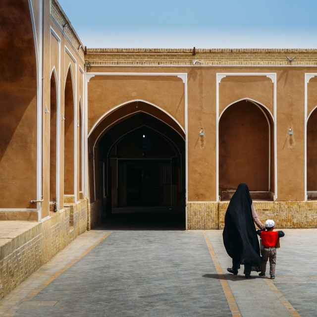 """Unidentifiable woman wearing a traditional black dress in Iran, known as a..."" stock image"