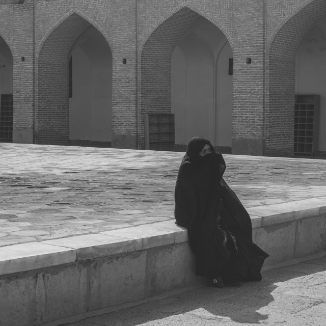 """Traditionally dressed older woman in a chador front of Jameh Mosque, Masjed-i..."" stock image"