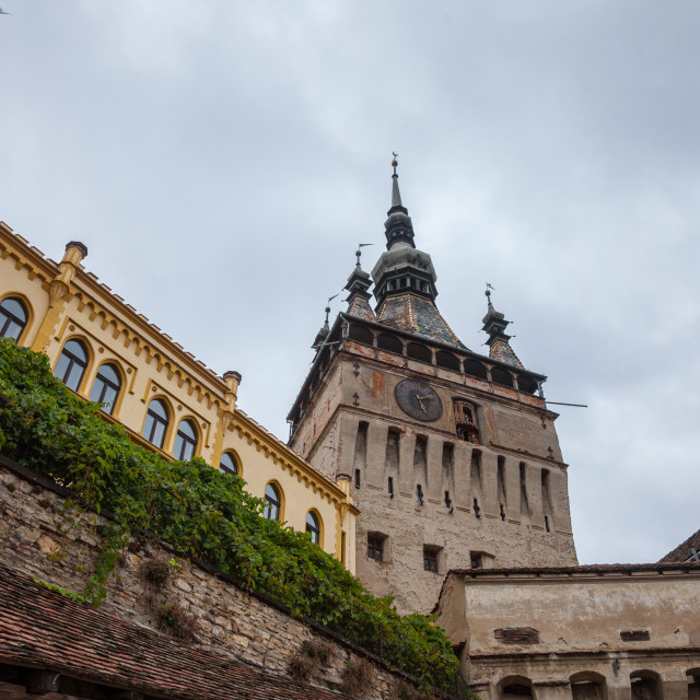 """""""Sighisoara Clock Tower (Turnul cu Ceas) during a cloudy fall afternoon. It is..."""" stock image"""