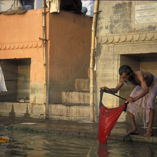 """Man washing clothers on Ganges"" stock image"