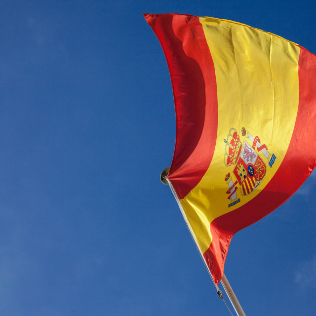 """""""Picture of the Spanish flag waiving in the air on a sunny afternoon with a..."""" stock image"""