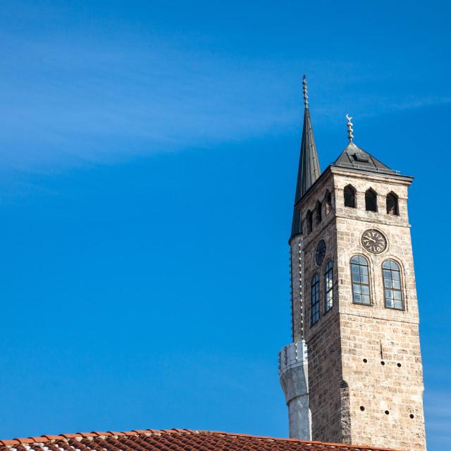 """""""Minaret of the Gazi Husrev begova Mosque next to the clocktower of Sarajevo..."""" stock image"""