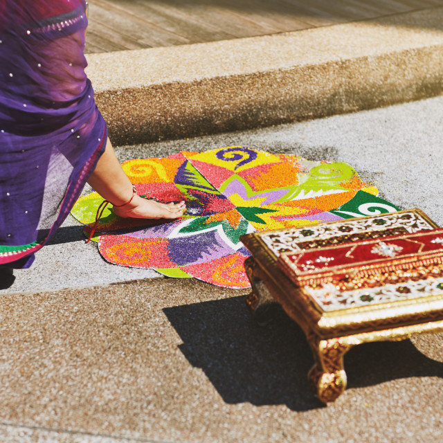 """""""Women coloring traditional rice art pattern (Rangoli) for indian marriage rituals"""" stock image"""