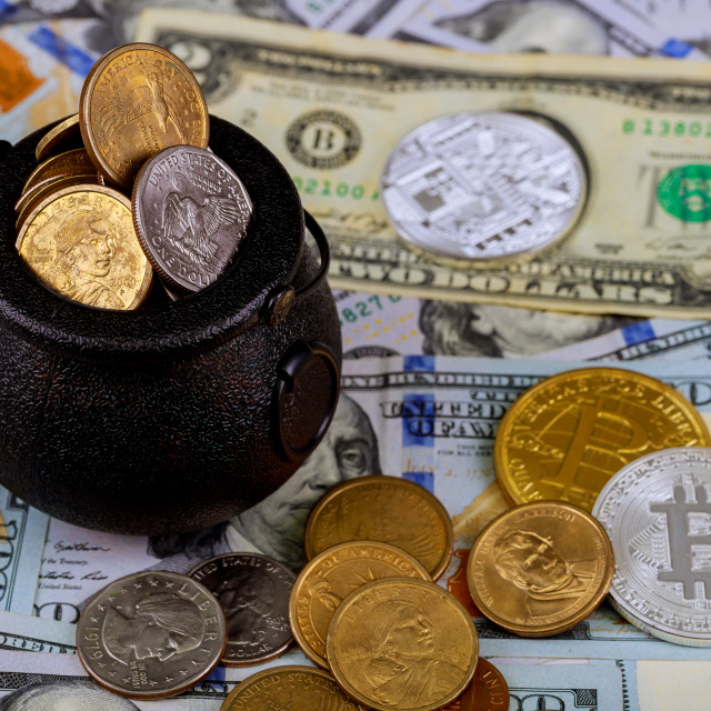 """""""Two symbolic coins of bitcoin on banknotes of one hundred dollars cash for a dollar."""" stock image"""