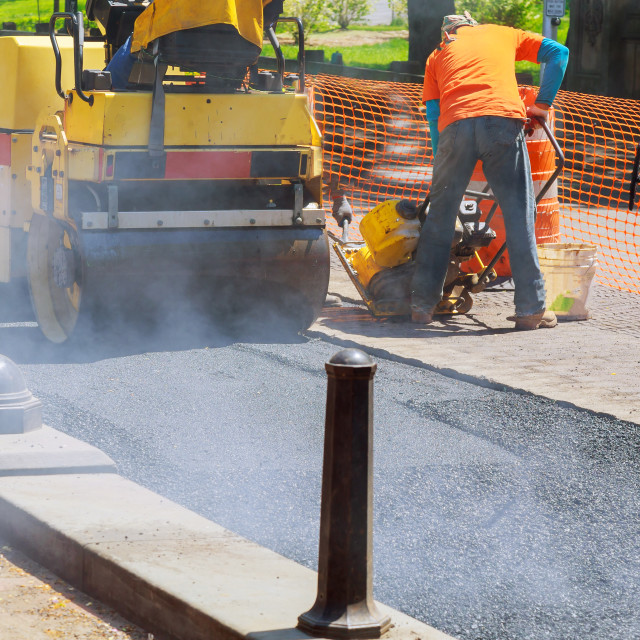 """road repairing in urban modern city with heavy vibration roller compactor"" stock image"