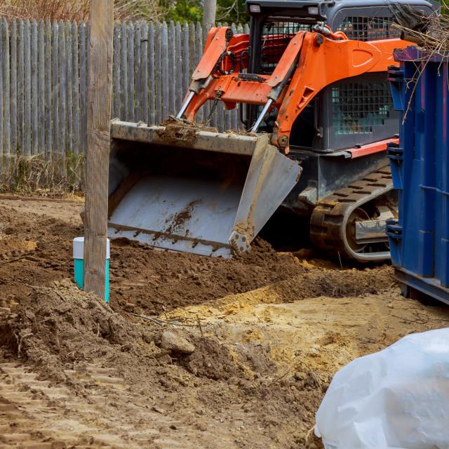 """Wheel loader excavator with backhoe unloading clay"" stock image"