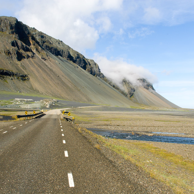 """Iceland empty road to mountains"" stock image"