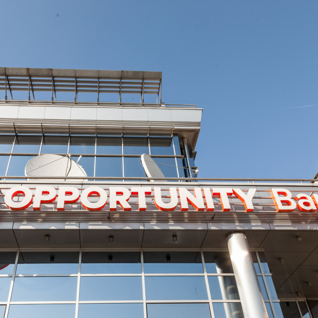 """""""BELGRADE, SERBIA - APRIL 29, 2018: Logo of Opportunity Bank on their local headquarters for Serbia. Opportunity International is an NGo specialized in micro loans and microfinance"""" stock image"""