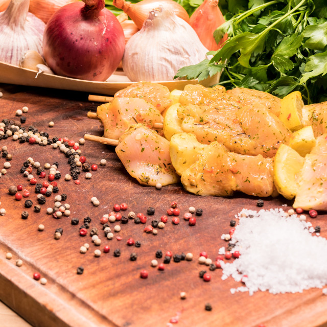 """raw chicken skewers marinated with lemon on a wooden board"" stock image"