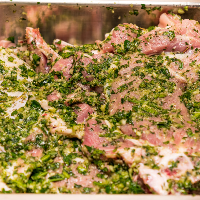 """raw meats marinated in garlic olive oil parsley salt pepper"" stock image"