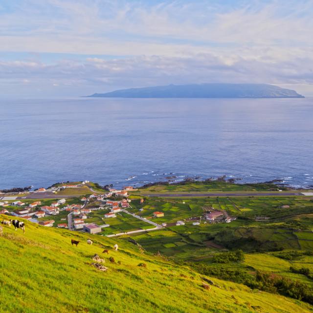 """Portugal, Azores, Corvo, View towards the Vila do Corvo with Flores Island on..."" stock image"