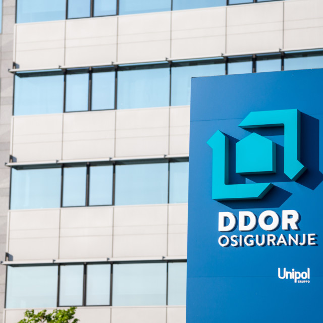 """""""BELGRADE, SERBIA - APRIL 29, 2018: DDOR Osiguranje insurance logo on their main office in Serbia. DDOR Novi Sad is a Serbian insurance company, the Ithird largest in Serbia, offering auto, home, commercial and life insurance."""" stock image"""