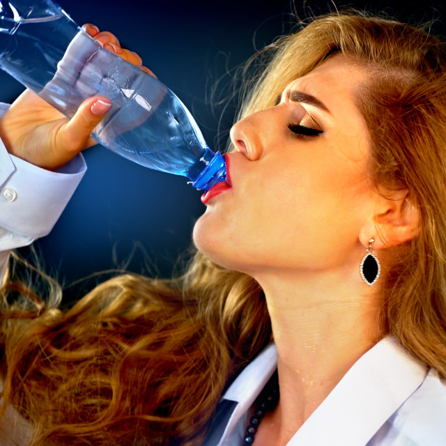 """Sensitive teeth woman drinking cold water from bottle. Sudden toothache."" stock image"