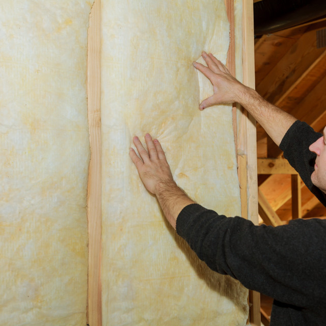 """Installation of Inside wall insulation in wooden house, building under construction"" stock image"