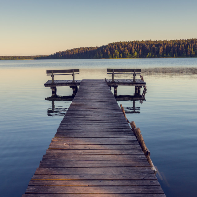 """Wooden footbridge on the lake"" stock image"