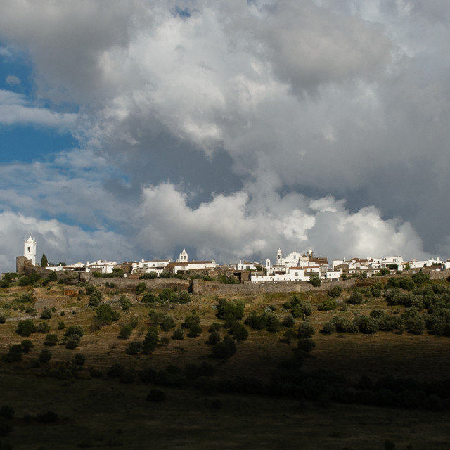 """Portugal Monsaraz village skyline with clouds"" stock image"