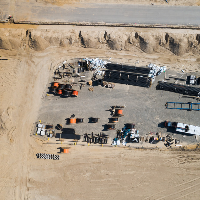 """""""Aerial view of the warehouse of a construction company at the edge of the..."""" stock image"""