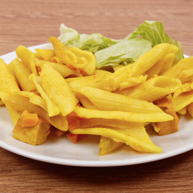 """""""Baked pasta with curry on a table"""" stock image"""