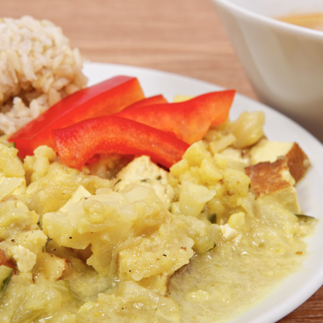"""""""Cauliflower mixture with curry and rice on a table"""" stock image"""