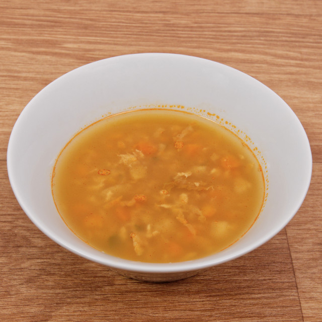 """""""Groat soup with vegetables on a table"""" stock image"""