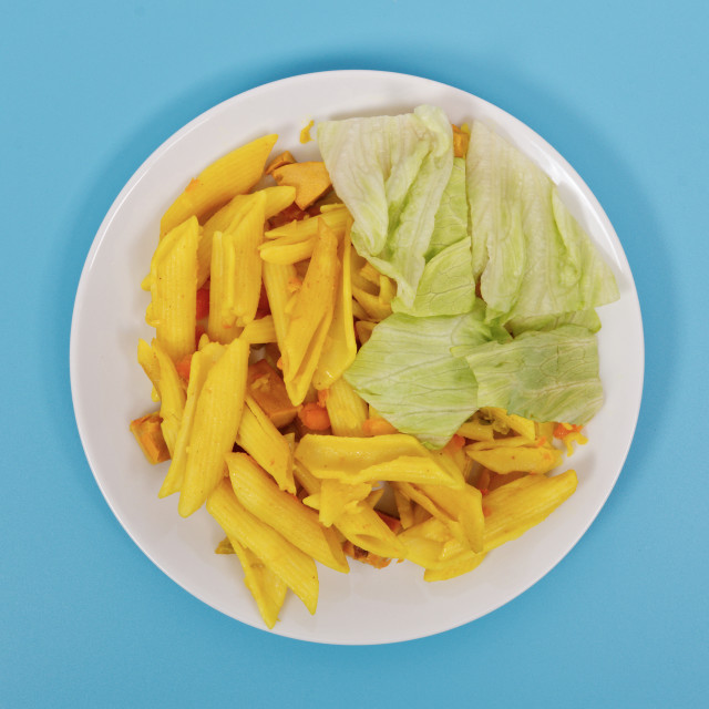 """""""Baked pasta with curry on a blue"""" stock image"""