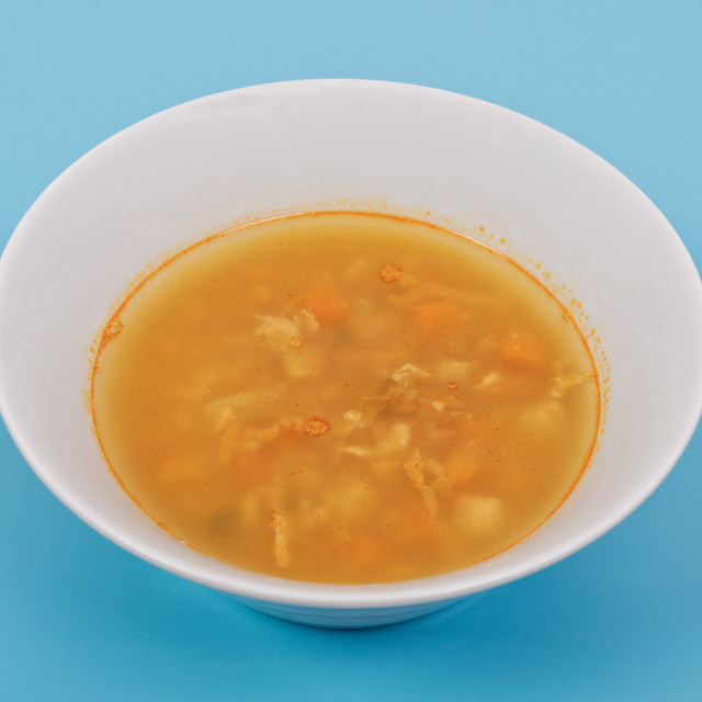 """""""Groat soup with vegetables on a blue"""" stock image"""