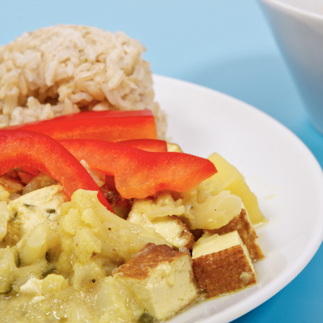 """""""Cauliflower mixture with curry and rice on a blue"""" stock image"""