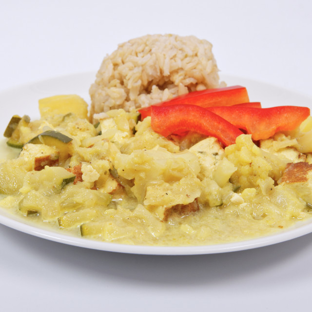 """""""Cauliflower mixture with curry and rice on a white"""" stock image"""