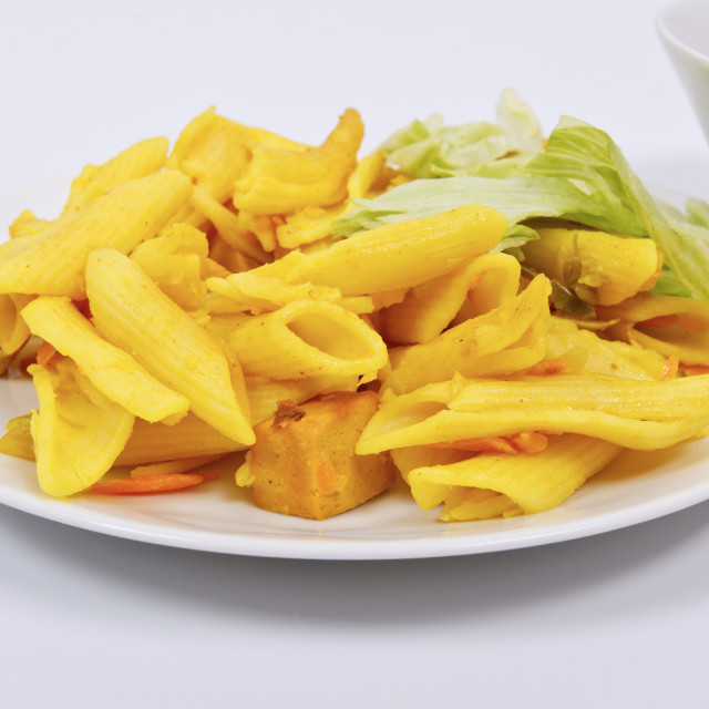"""""""Baked pasta with curry on a white"""" stock image"""