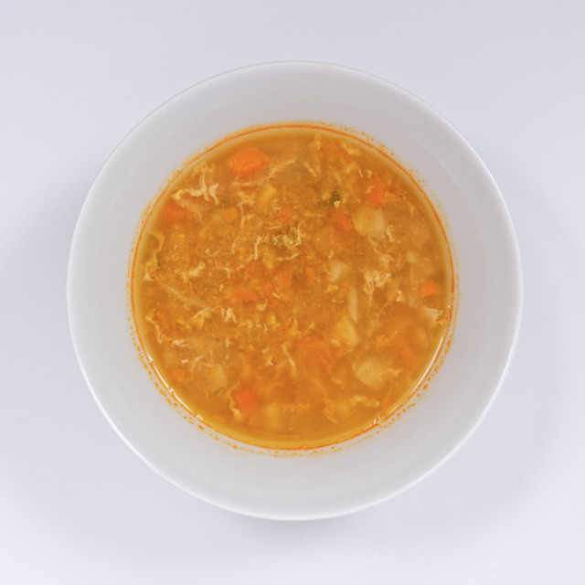 """""""Groat soup with vegetables on a white"""" stock image"""