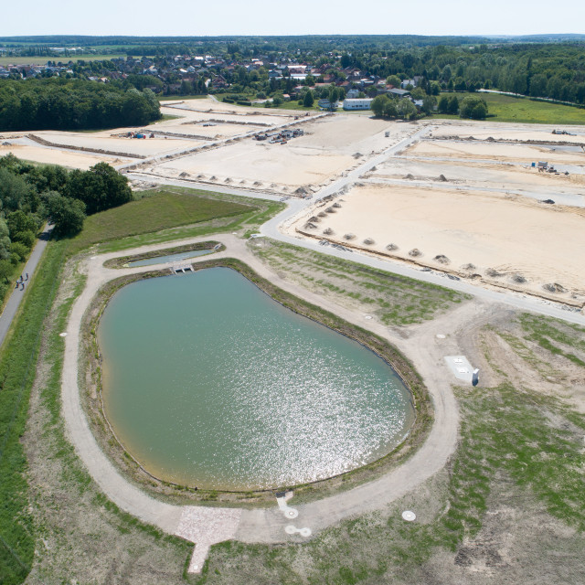 """""""Aerial view from a rainwater Basin and anew development area on sandy ground..."""" stock image"""