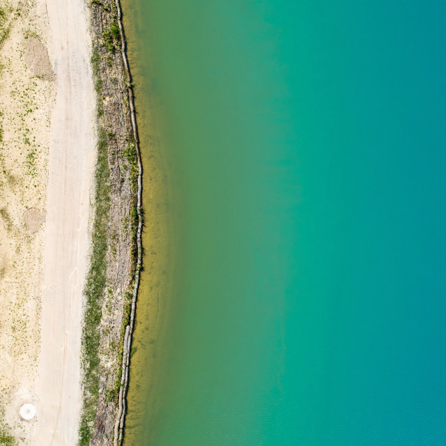 """""""Detailed view of the edge of a rainwater retention basin with turquoise..."""" stock image"""
