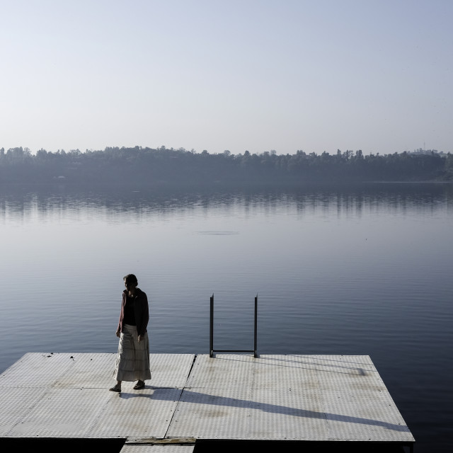 """Woman on dock"" stock image"