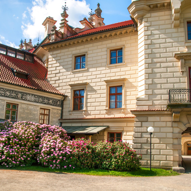 """""""Pruhonice Castle main entrance with Rhododendrons in full bloom"""" stock image"""